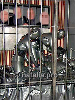 "rubber-heavy-latex-prisoner-inmate-prison-jail-cage-punishment-penalty-mask-constraint-bondage-warden-chain-masochist-masochistic-devot-submissive-sub-kidnapping"" title="